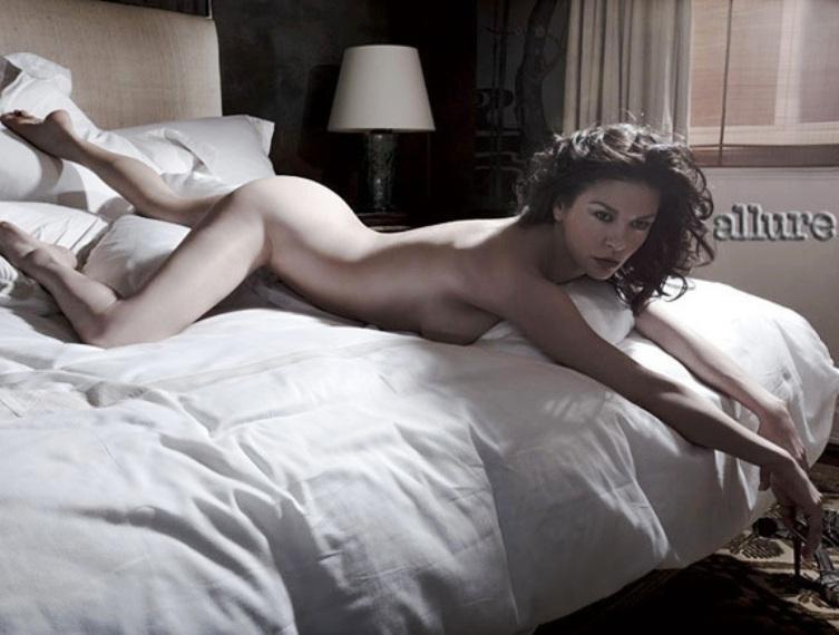 Catherine Zeta-Jones completely Nude Lying on the Bed Magazine photo