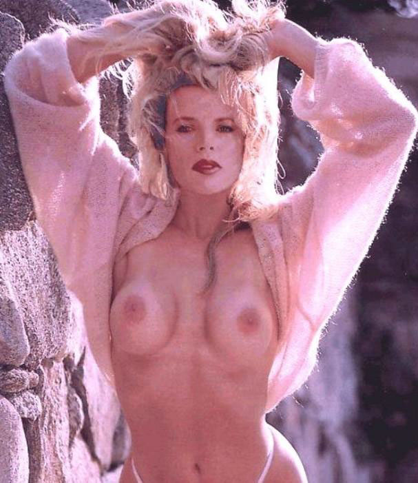 Kim Basinger Nude Boobs Showing While Wearing A Pink Sweater
